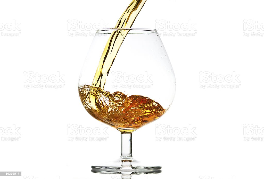filling a glass of brandy royalty-free stock photo