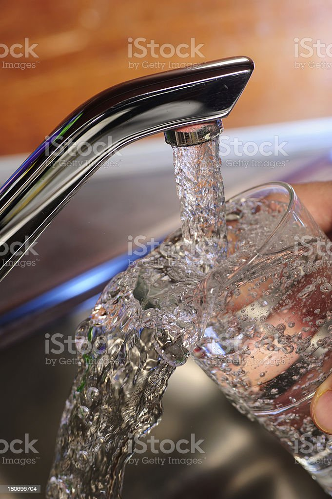 Filling a glass of water - swapping over royalty-free stock photo