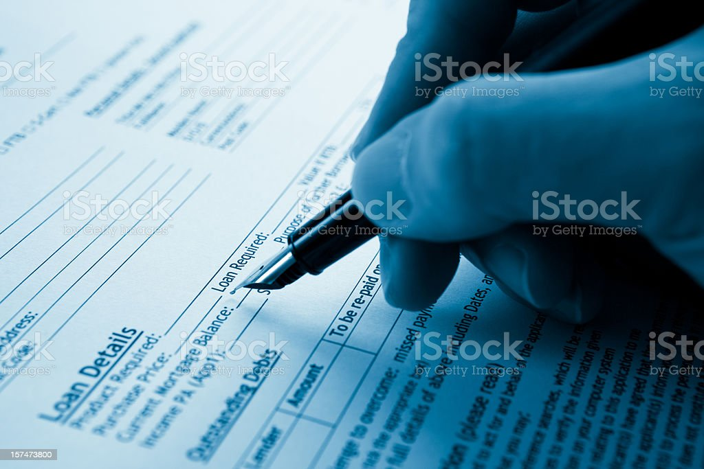 Filling a mortgage form royalty-free stock photo