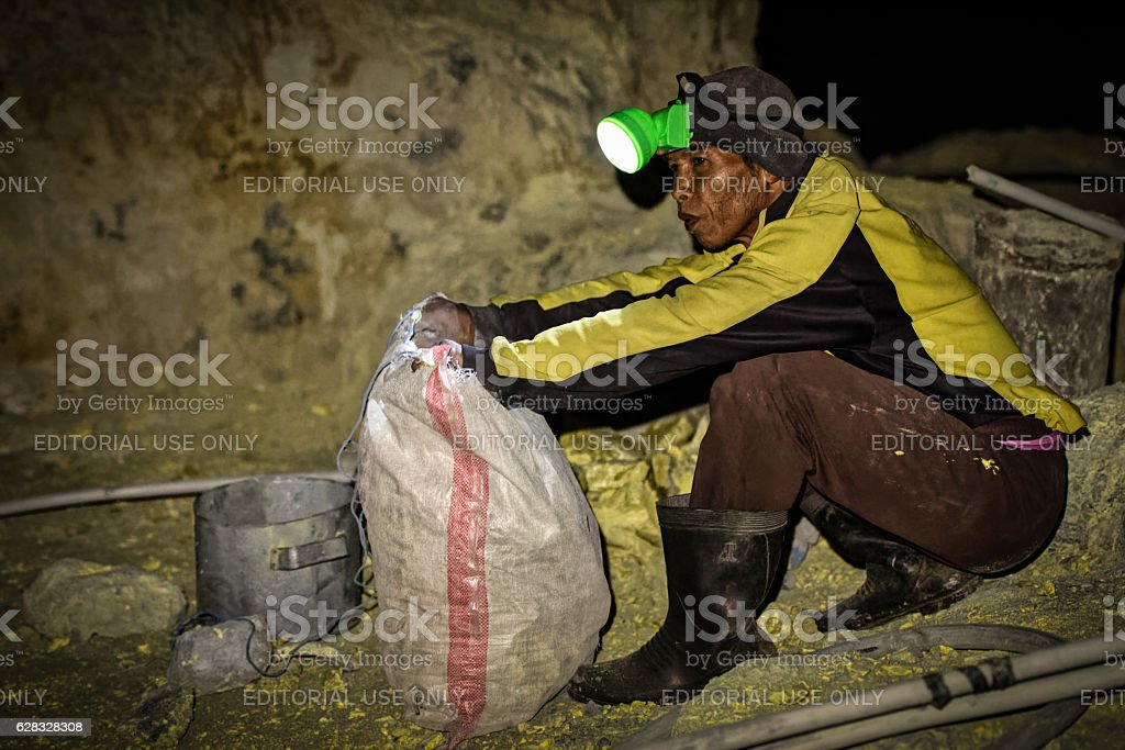 Filling a sulphur sack, at Ijen crater stock photo