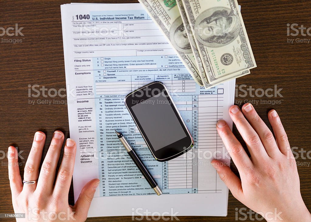 Filling a tax form royalty-free stock photo