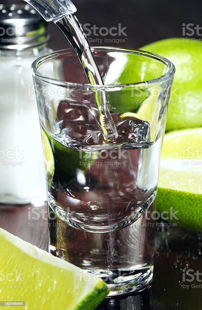 Filling a tequila shot stock photo