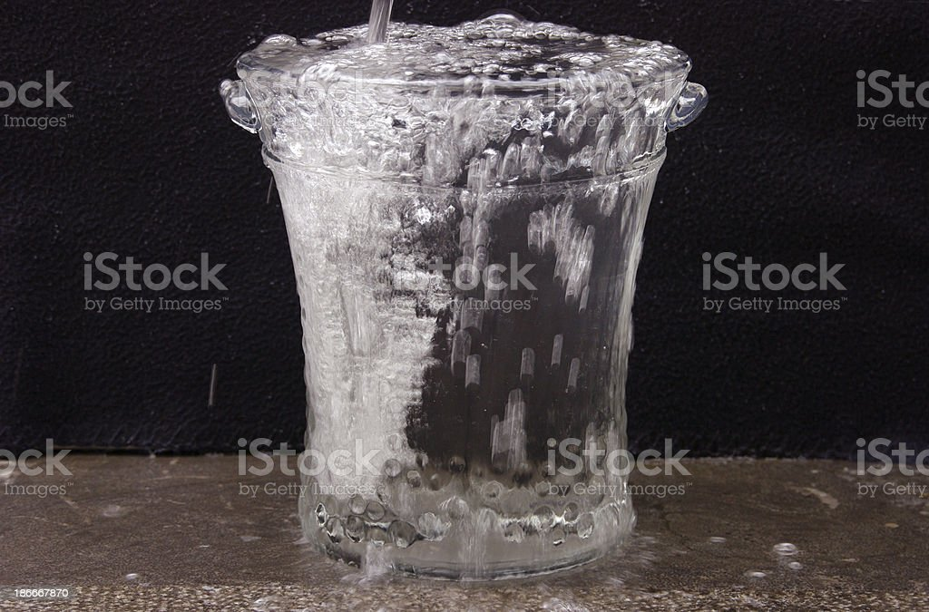 Filling a vase with water stock photo