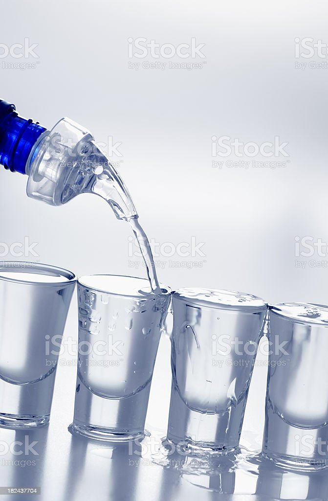 filling alcohol shot glass royalty-free stock photo