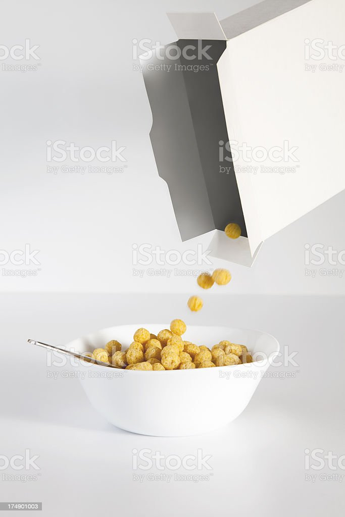 filling bowl with cereal stock photo