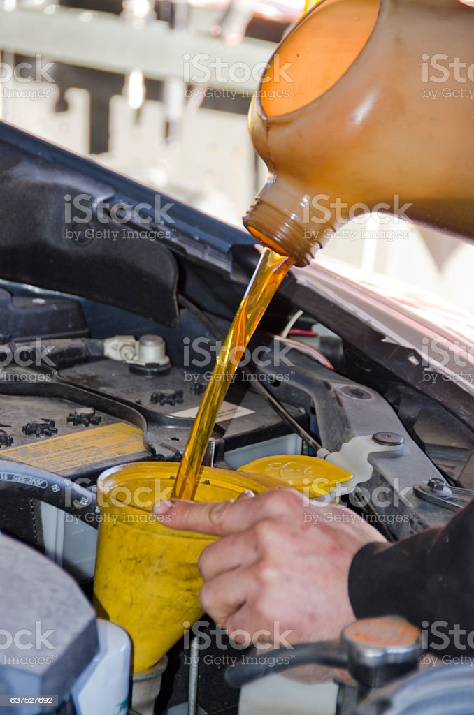 Filling Car Engine with Fresh Motor Oil stock photo