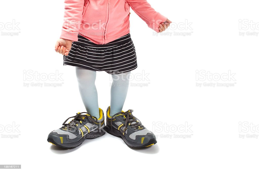 Filling daddy´s shoes stock photo