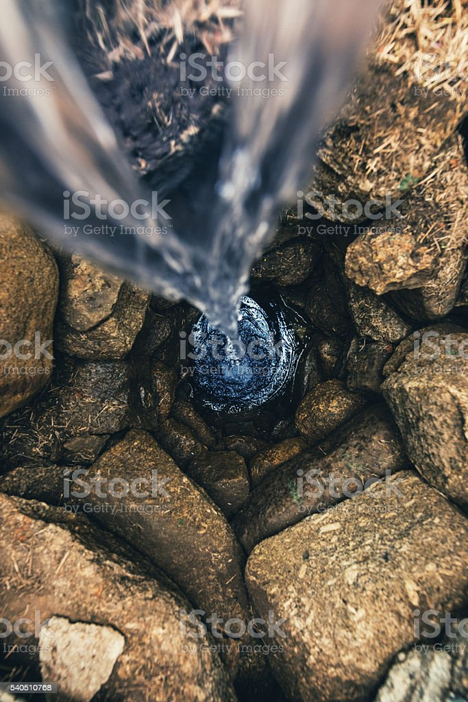 Filling Deep Well stock photo