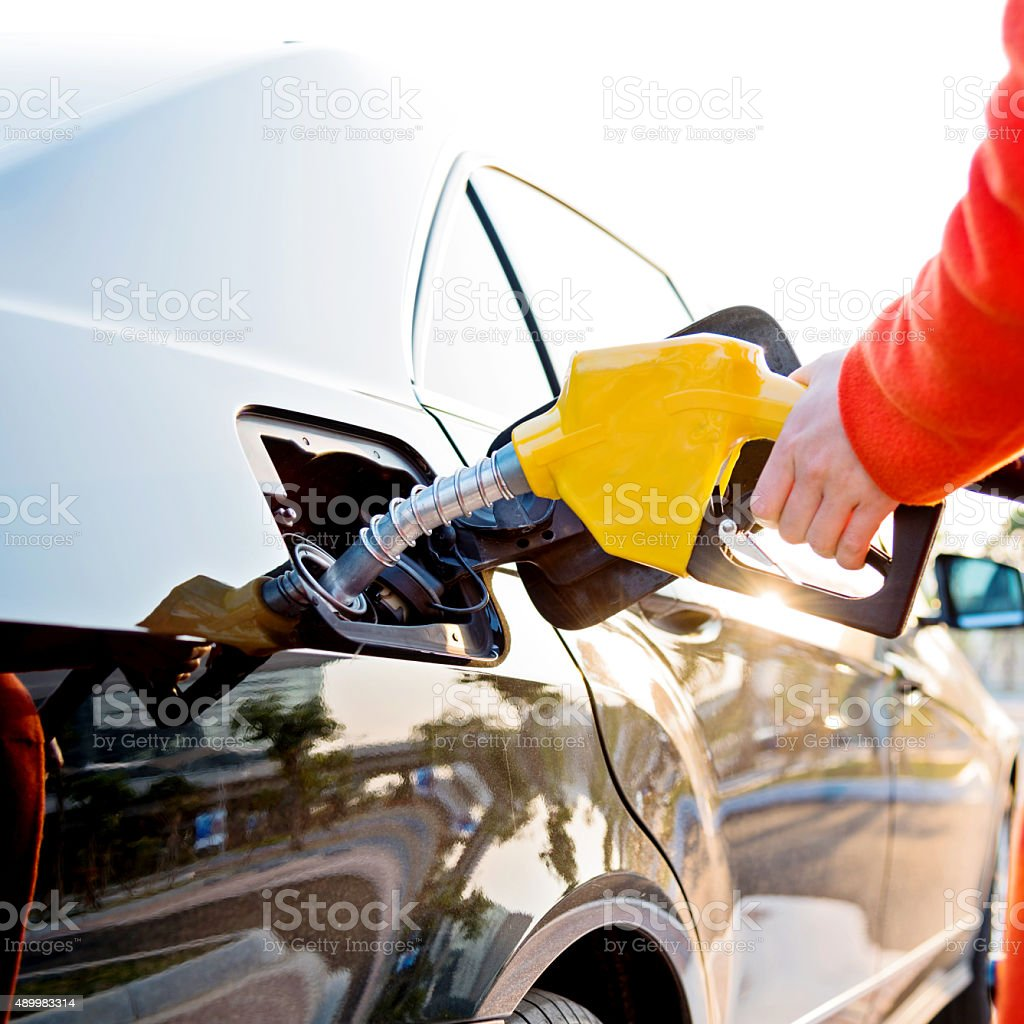 filling fuel stock photo