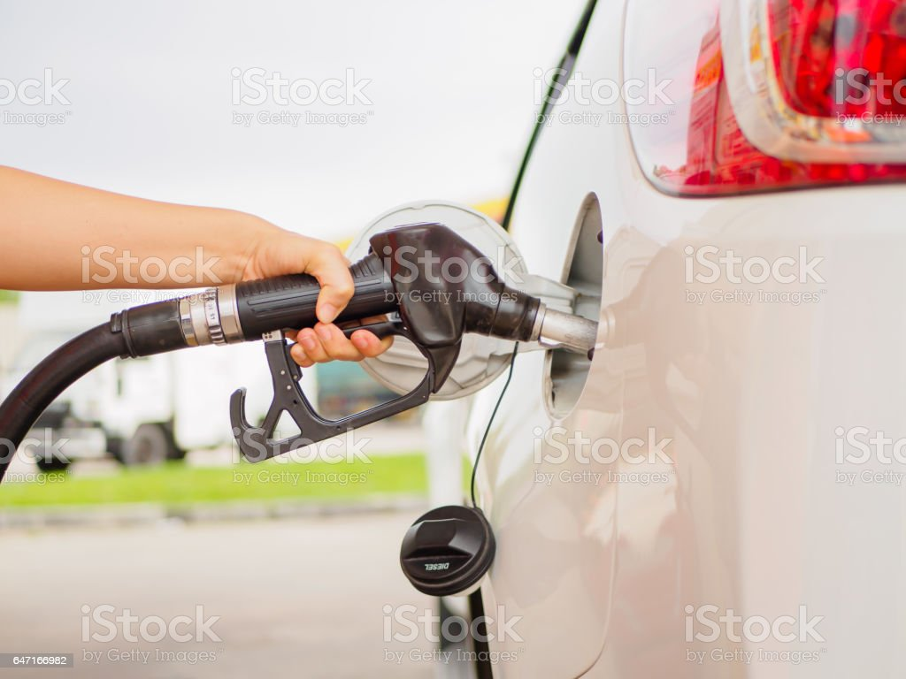 Filling gas at the station. Fill the gas tank. Self service. Gas pump in the car. Refill oil, gasoline, diesel vehicle stock photo