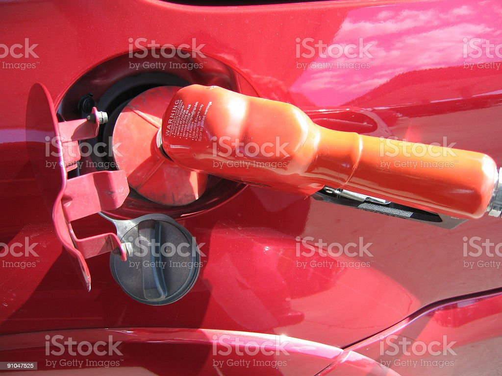 Filling gas in a truck royalty-free stock photo
