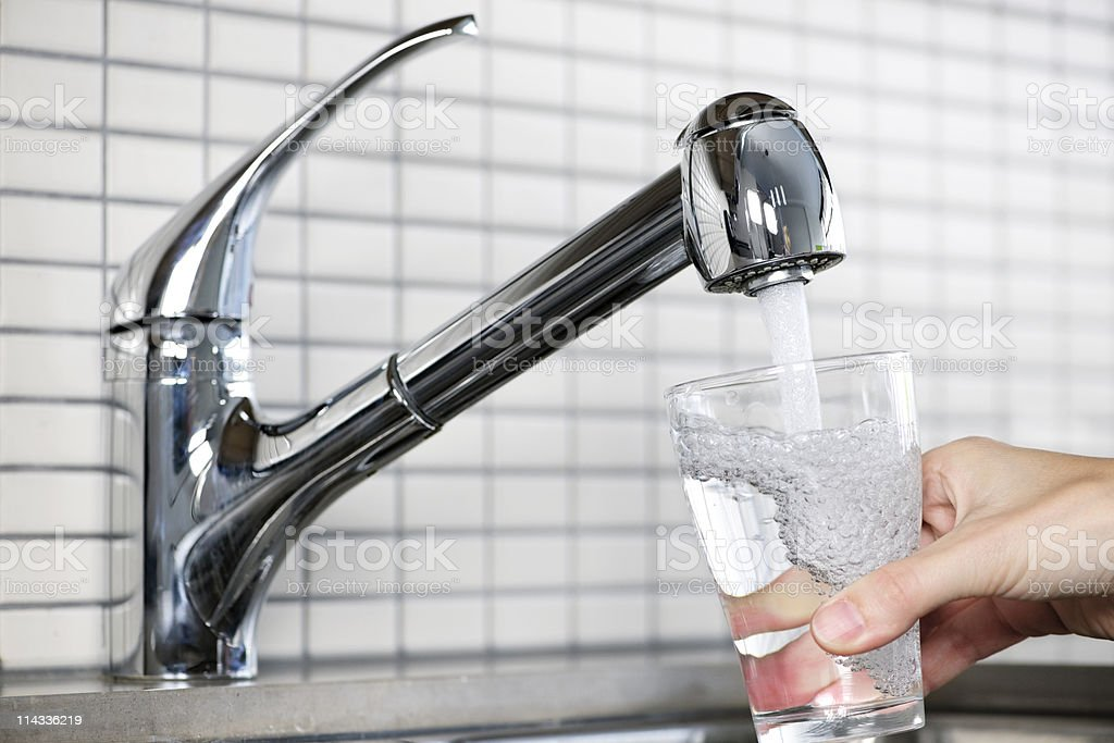 Filling glass of tap water stock photo