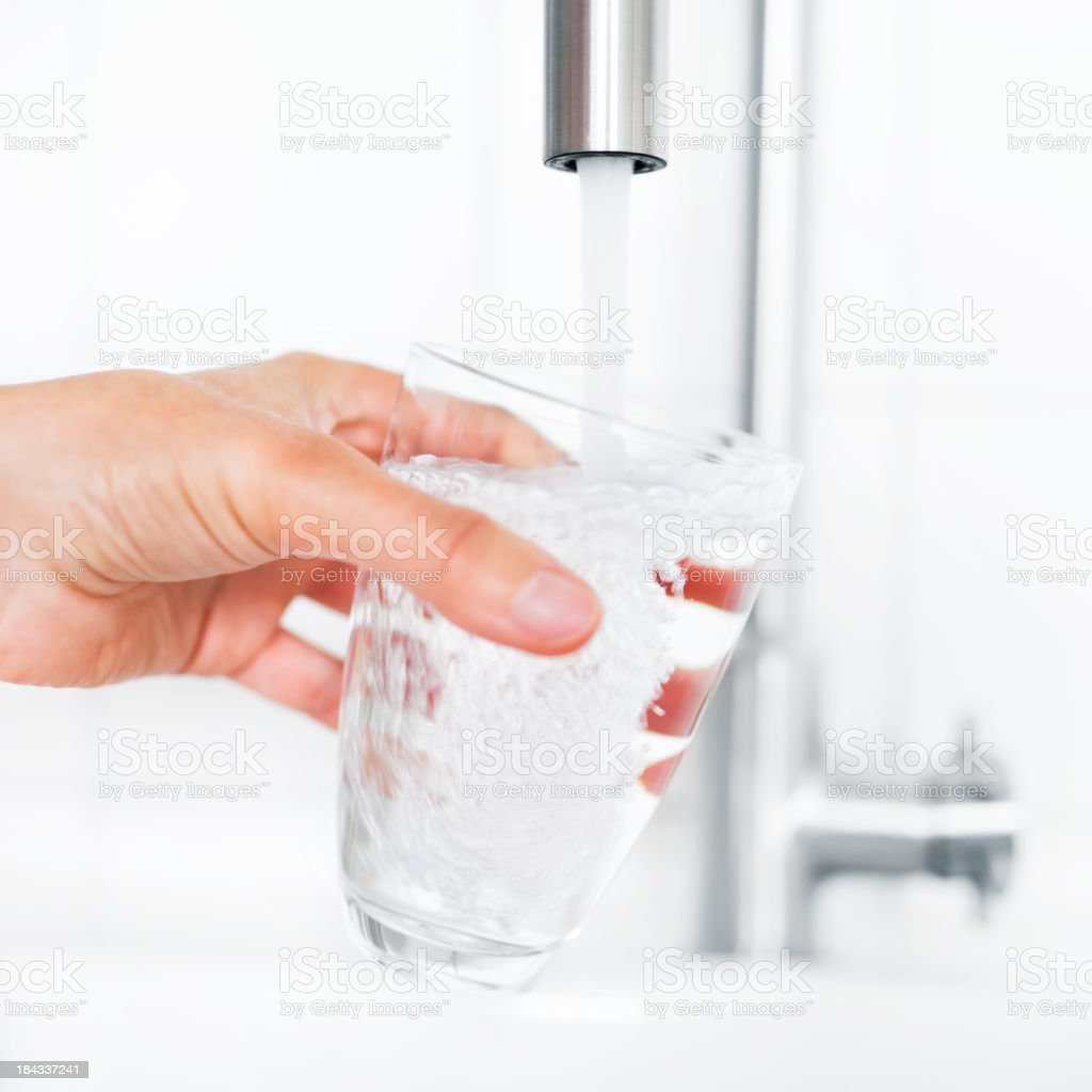 Filling Glass of Water stock photo