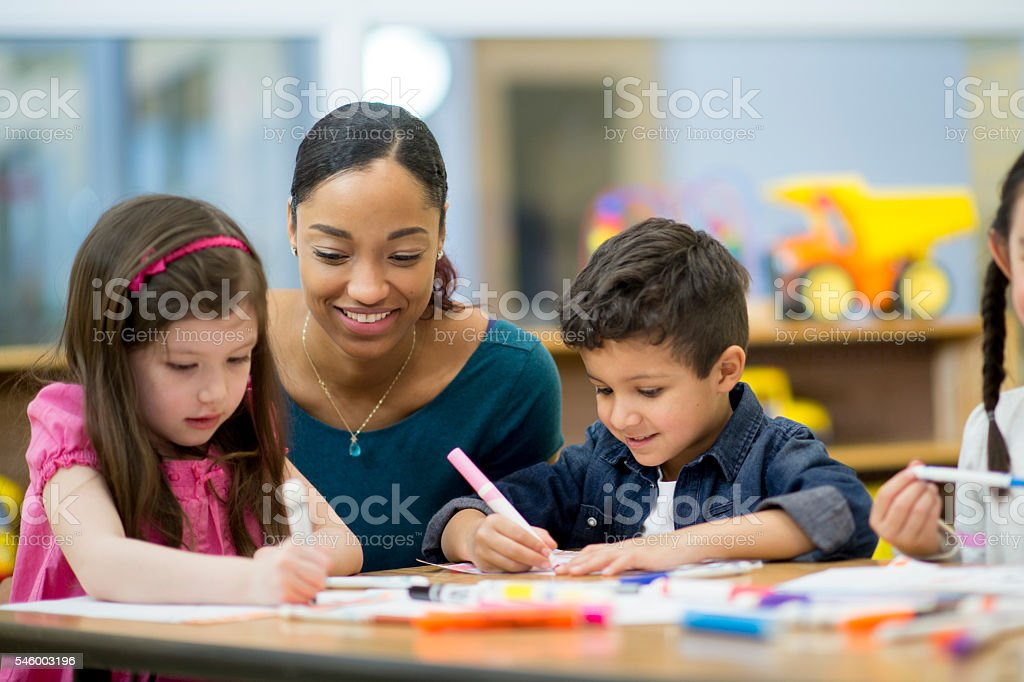 Filling in a Coloring Book stock photo