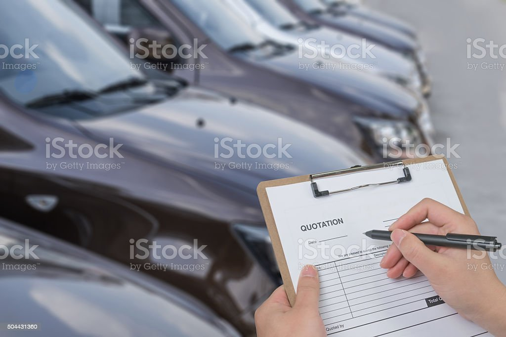 filling in a quote form for car stock photo