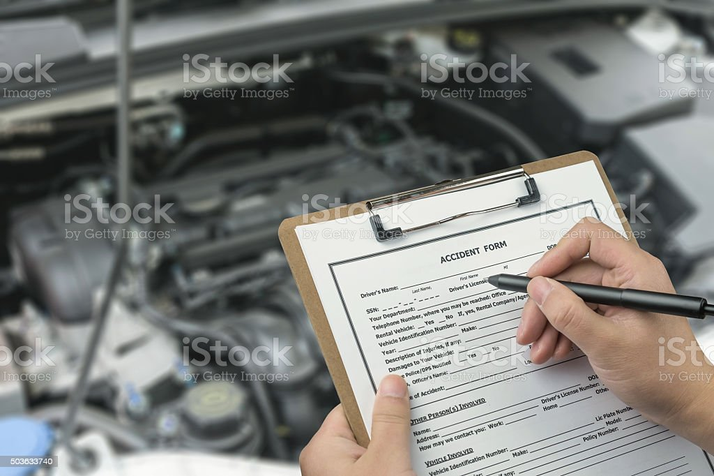 Filling in accident report stock photo