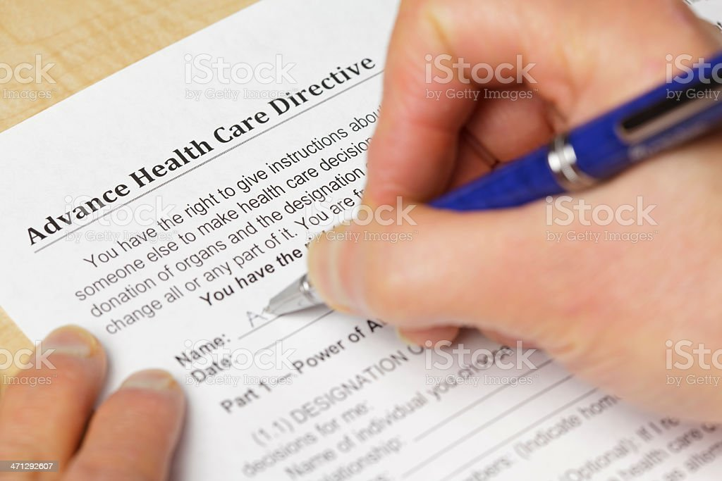 Filling in an advance health care directive stock photo