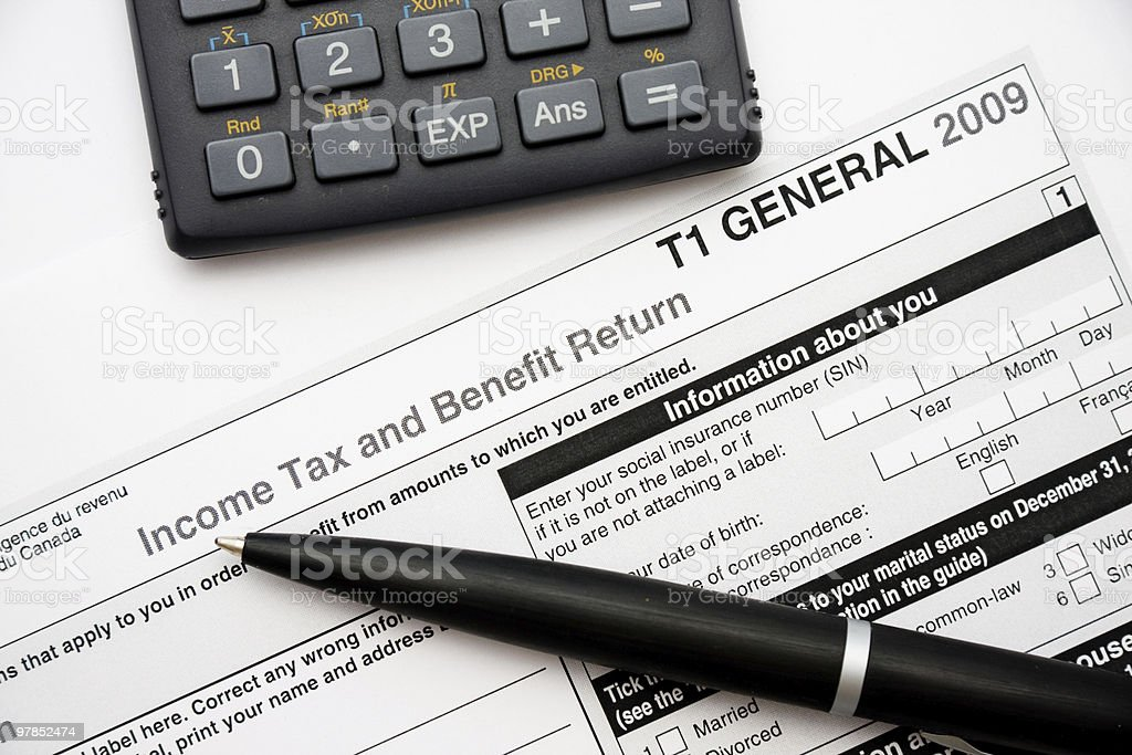 Filling in canadian tax form stock photo