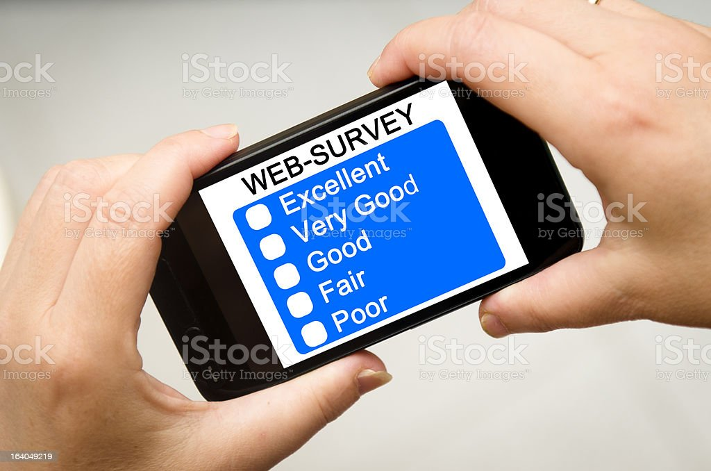 Filling Online web survey Questionnaire on smartphone royalty-free stock photo