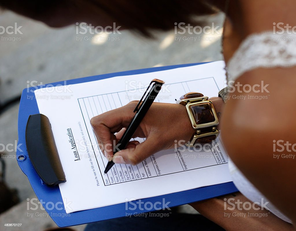 Filling Out a Loan Application royalty-free stock photo