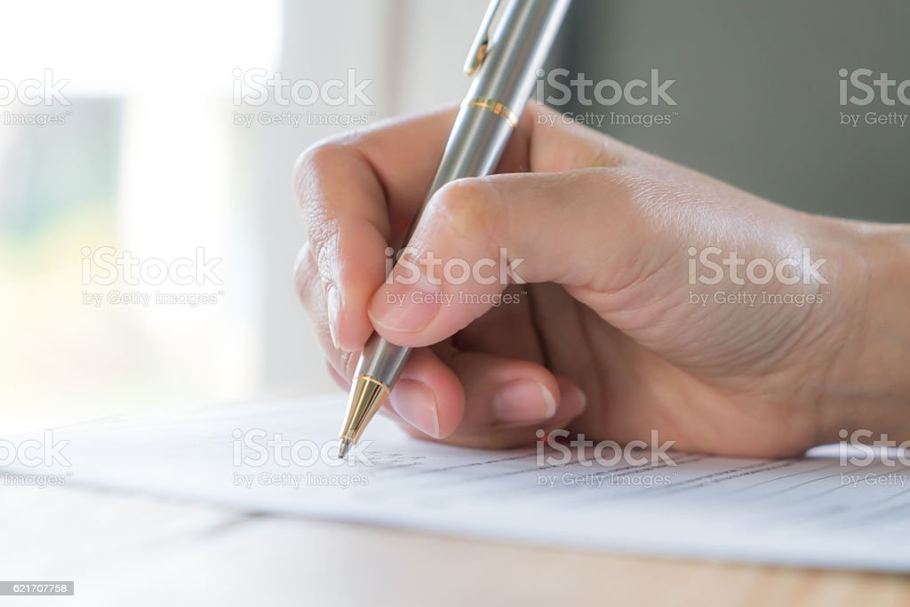 Filling out application form stock photo