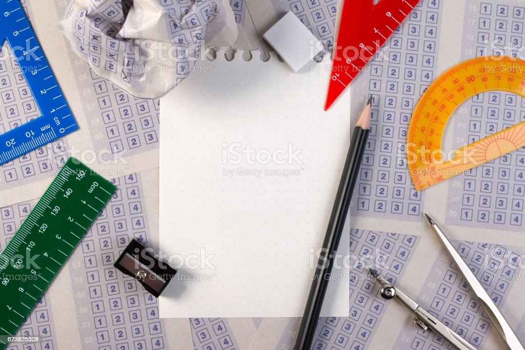 Filling out in answer sheet, pencil, sharpener, paper reduction and the word studying is boring. stock photo