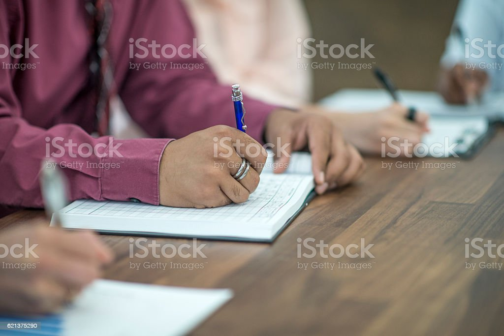 Filling Out Paperwork at the Office stock photo