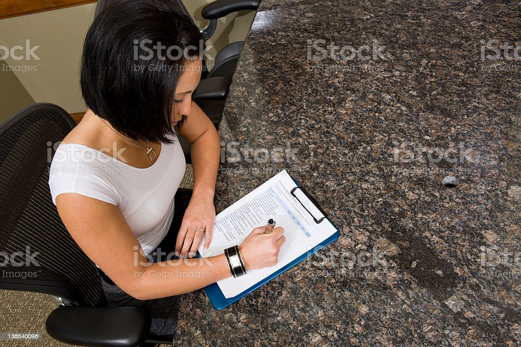 Filling Out Paperwork royalty-free stock photo