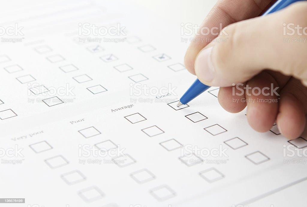 Filling out the questionnaire stock photo
