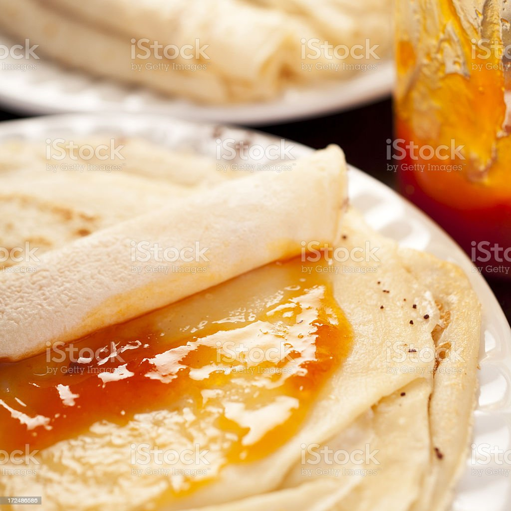 Filling Pancakes with Jam royalty-free stock photo