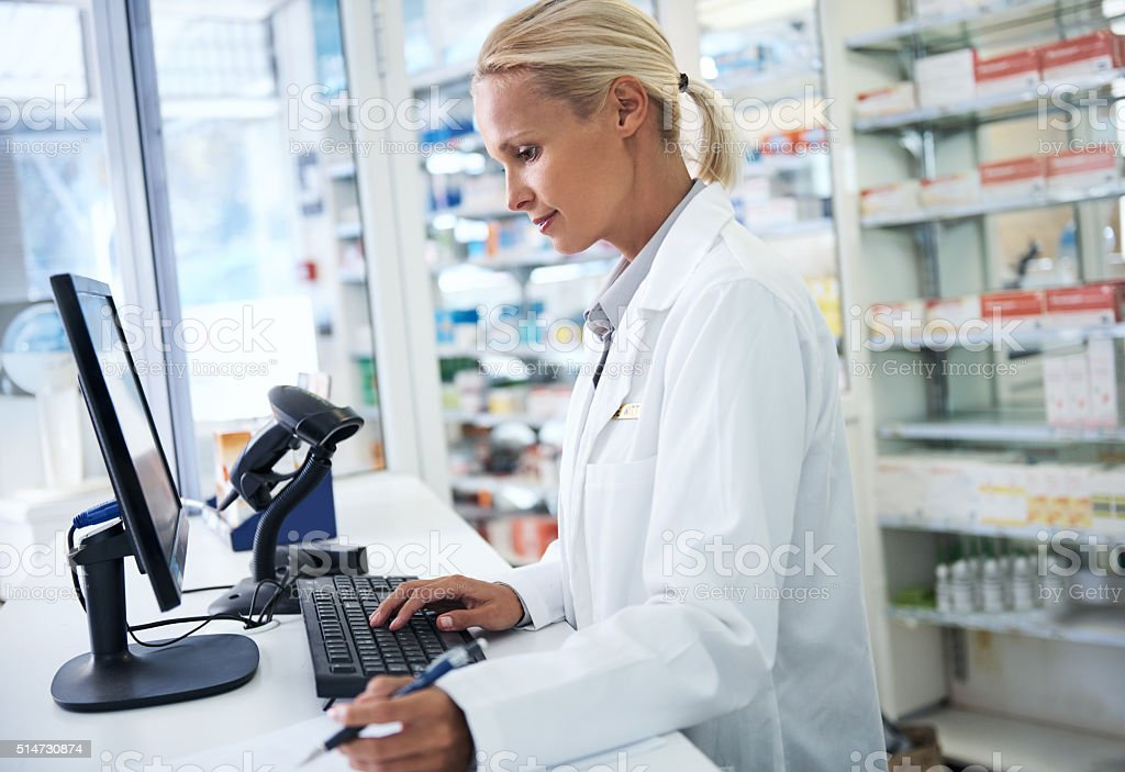 Filling prescriptions and customers' needs stock photo