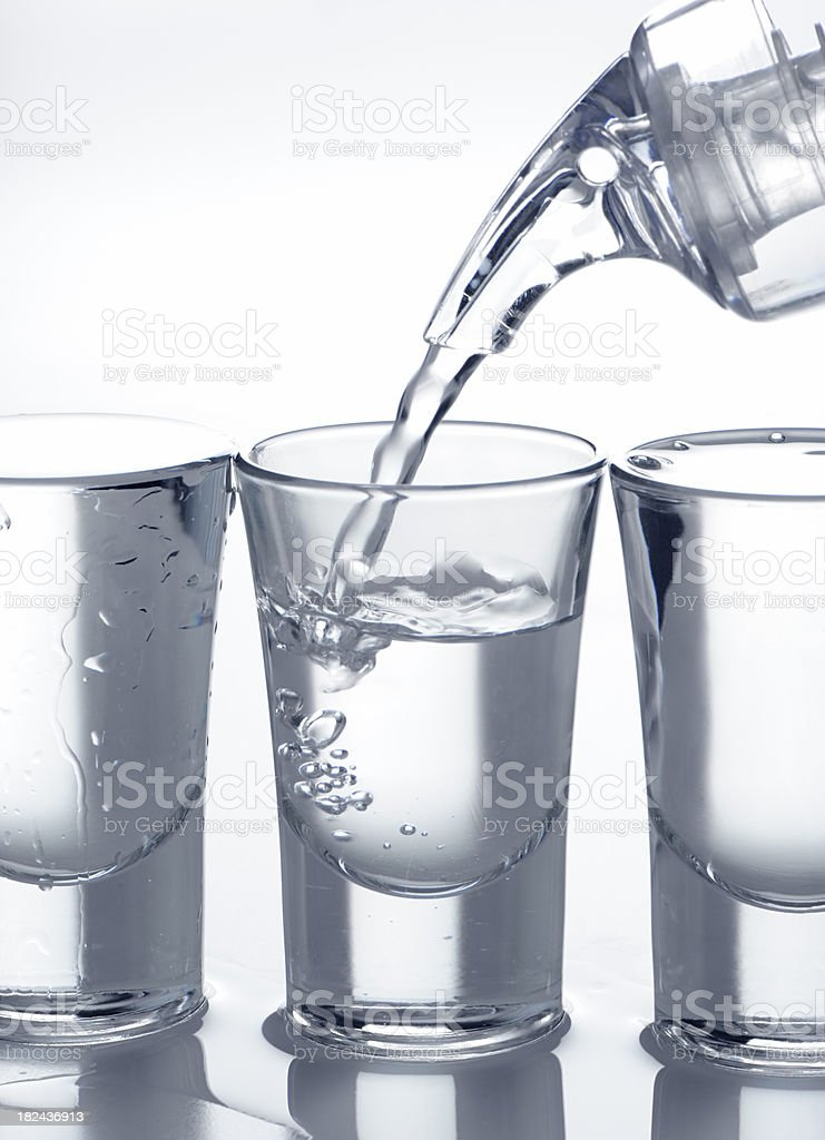 Filling shot glass royalty-free stock photo