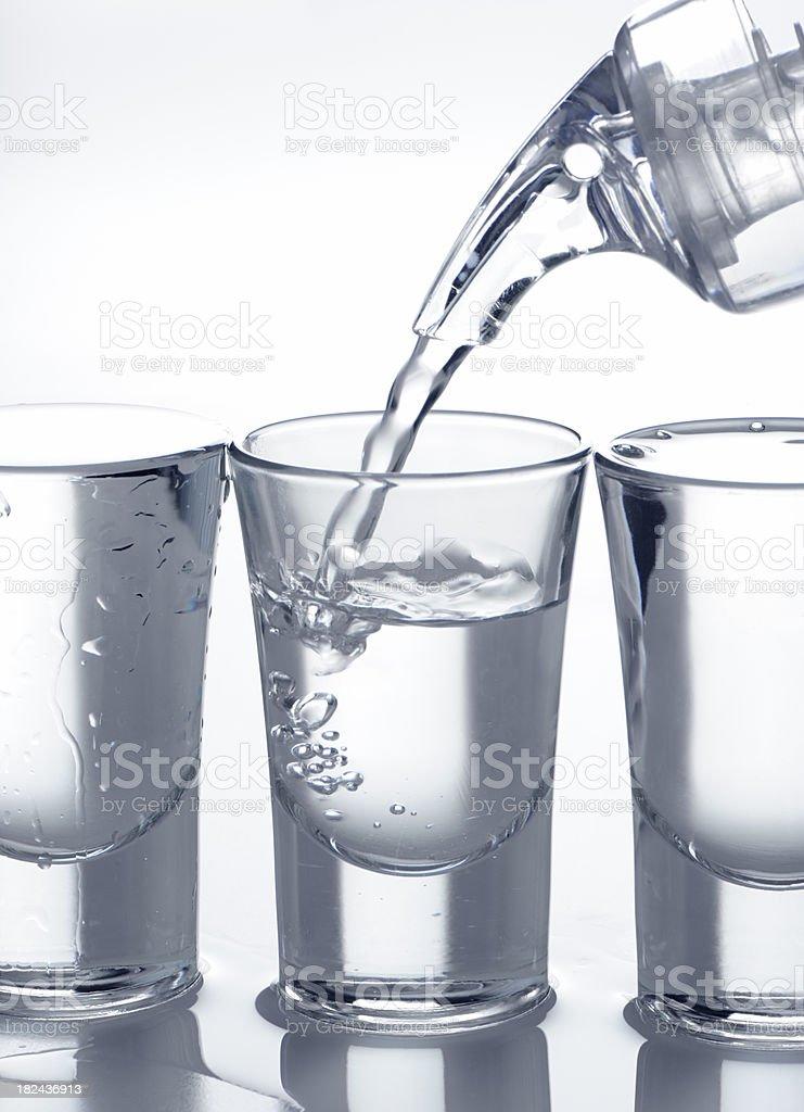 Filling shot glass stock photo