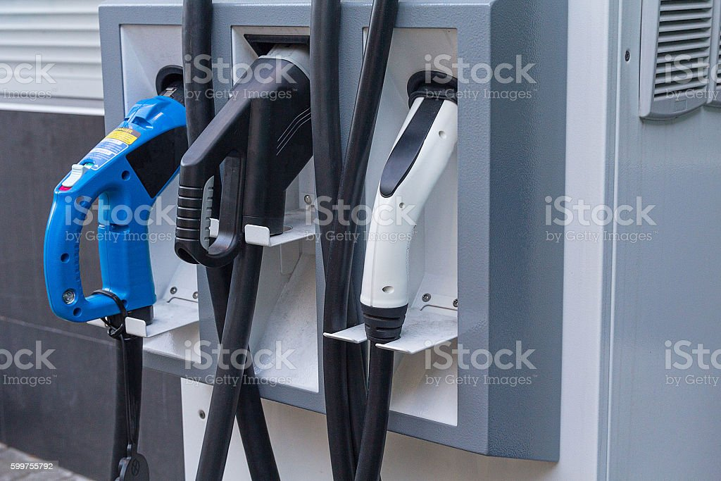 Filling station electric vehicle close up. Industry stock photo