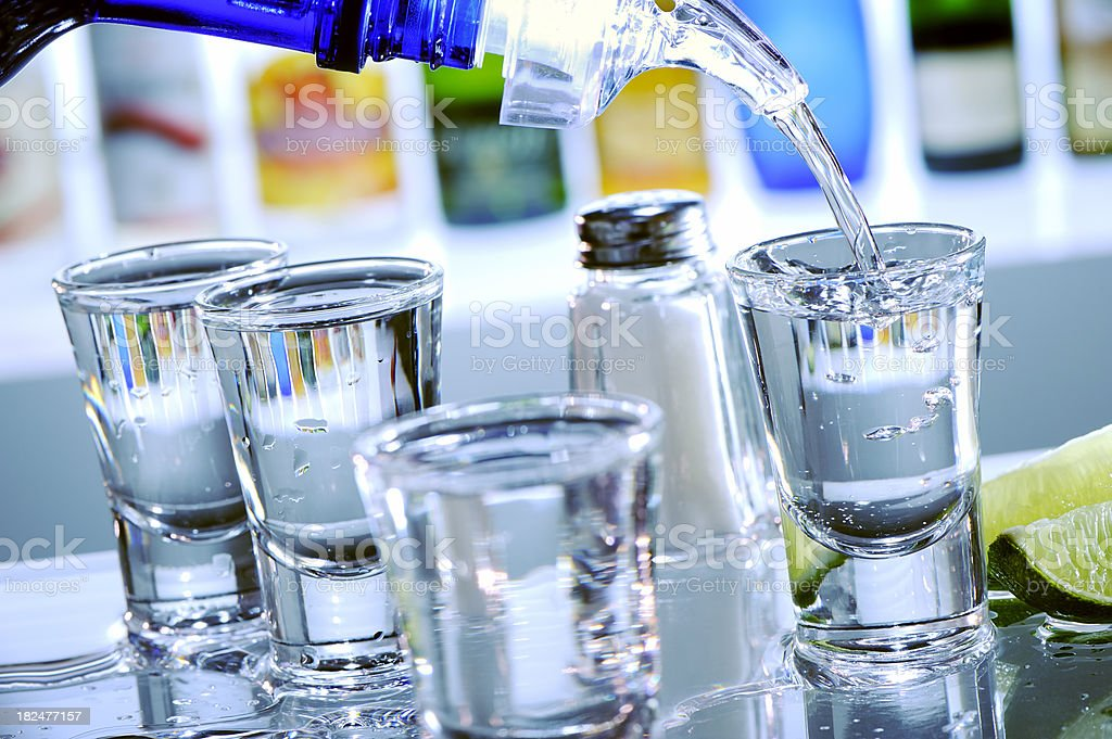 Filling tequila shot glasses royalty-free stock photo