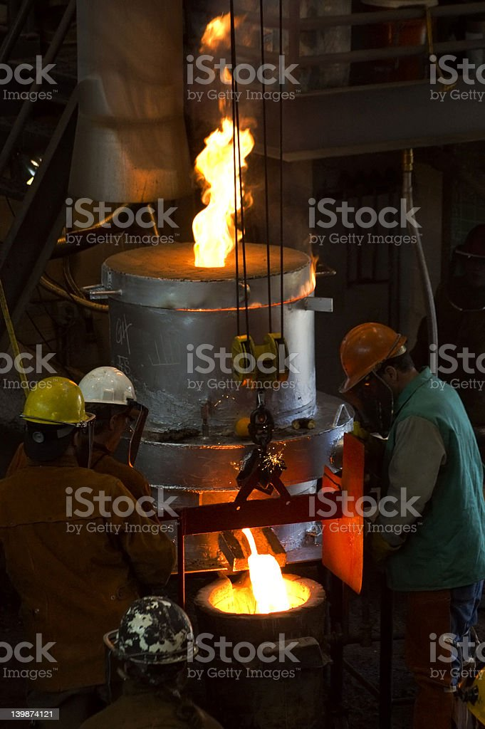 Filling the Bull Ladle royalty-free stock photo
