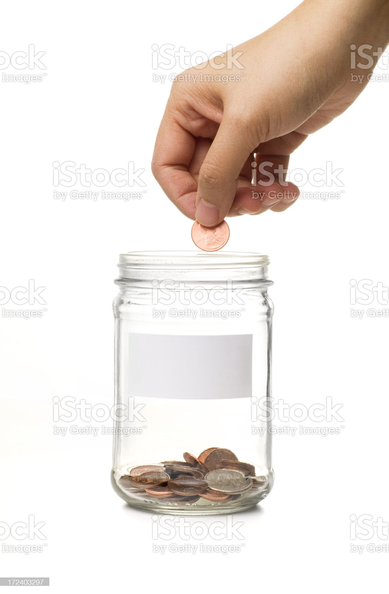 Filling the Coin Jar royalty-free stock photo