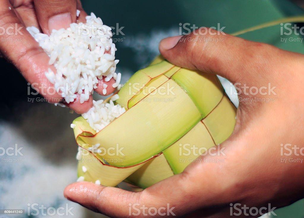 Filling the ketupat eid stock photo