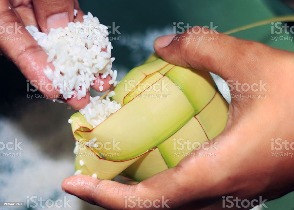 Filling the ketupat eid stock photo