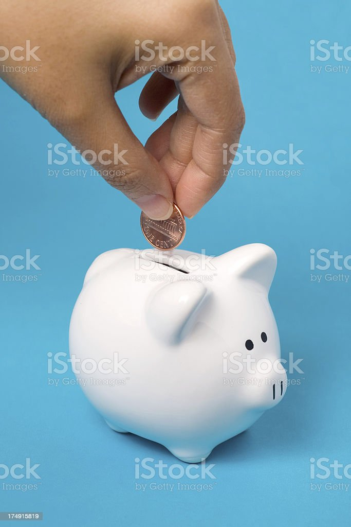 Filling the Piggy Bank royalty-free stock photo