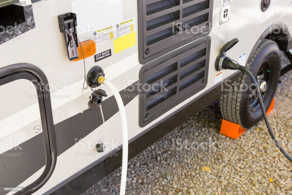 filling the water tank of a campervan stock photo