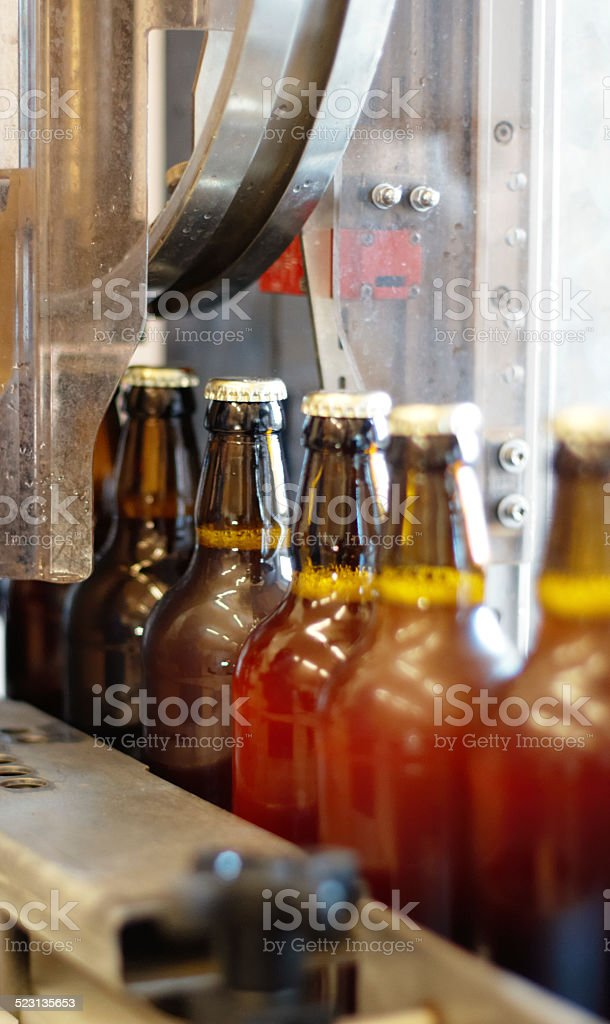 Filling those bottles with goodness stock photo