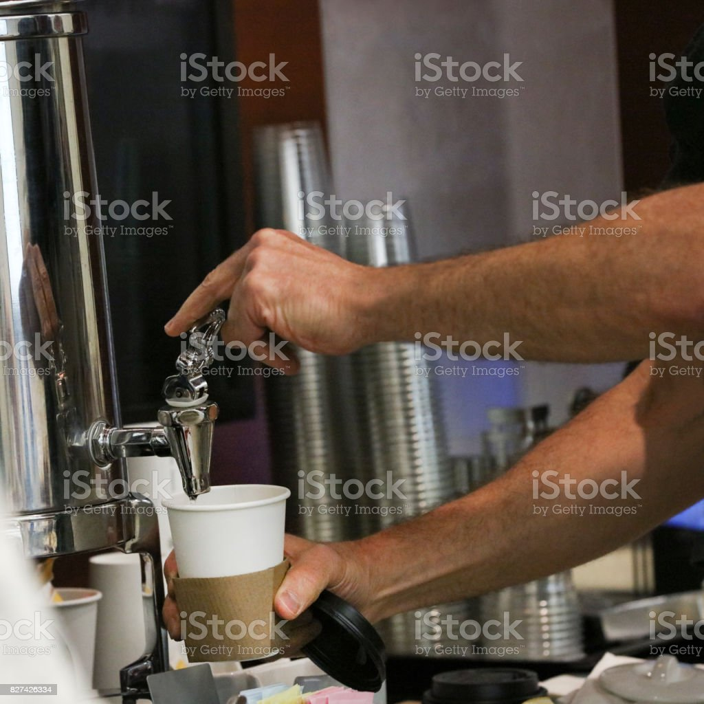 Filling Up A Drink stock photo