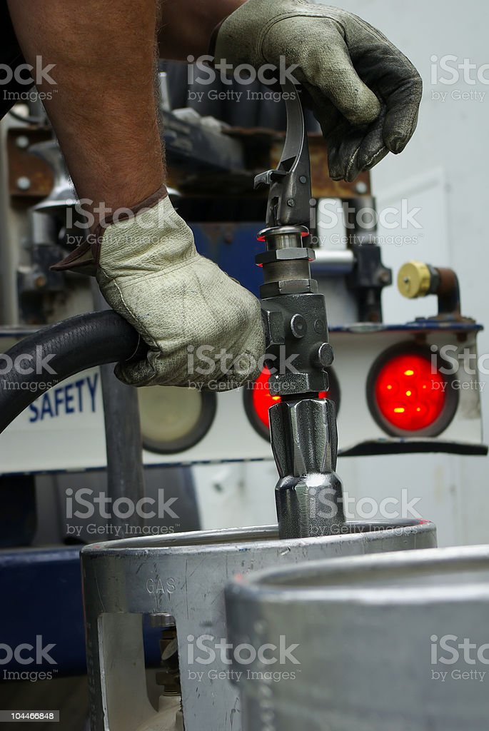 Filling up natural gas canisters royalty-free stock photo