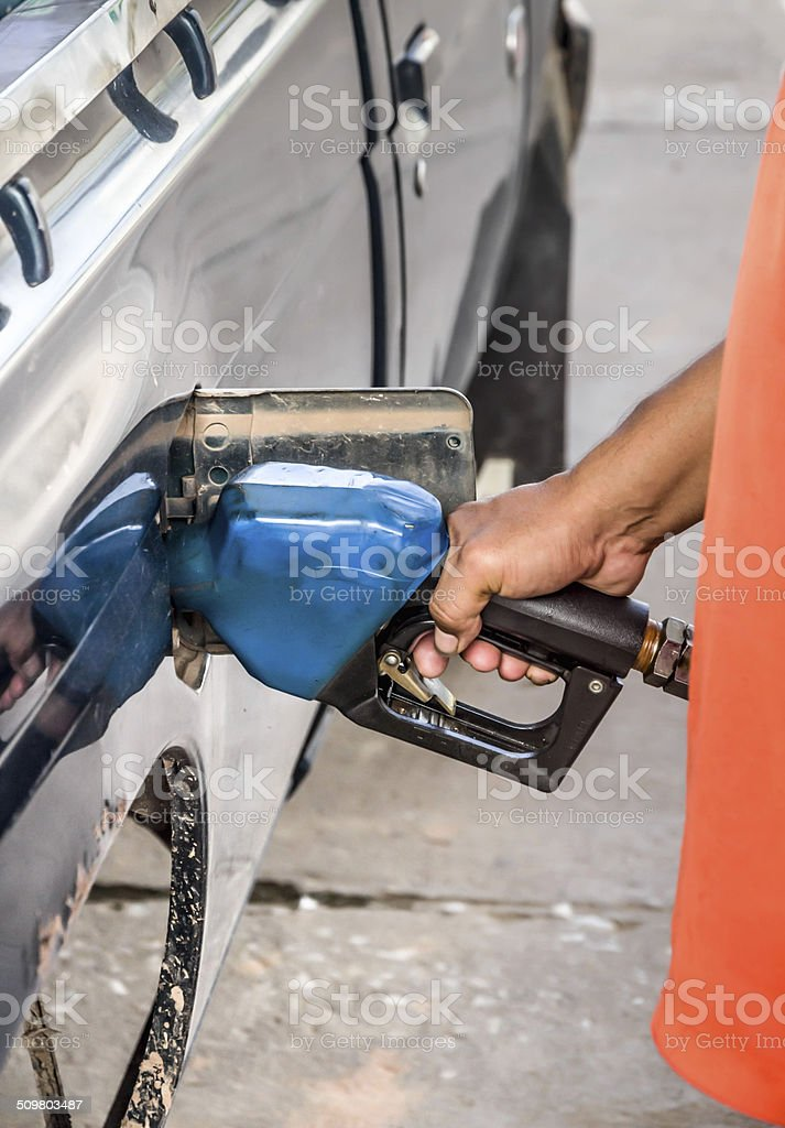 Filling up with gas to car stock photo
