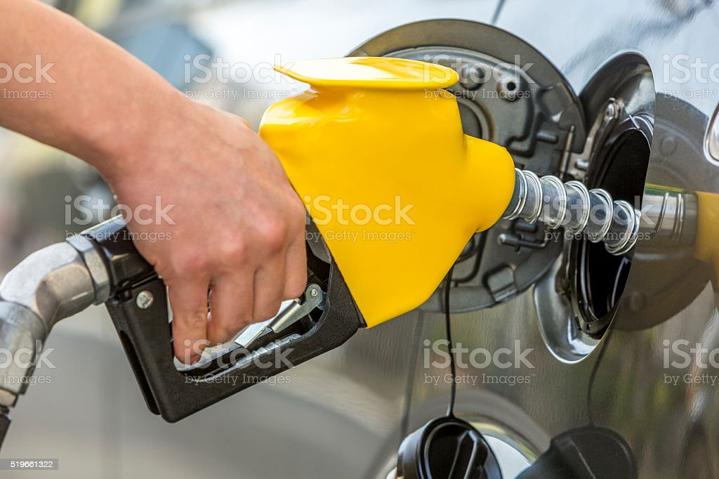 Filling up with gasoline stock photo