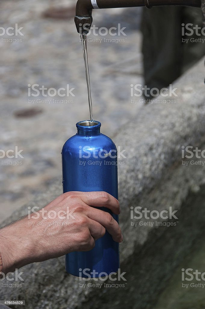 Filling Water Bottle royalty-free stock photo