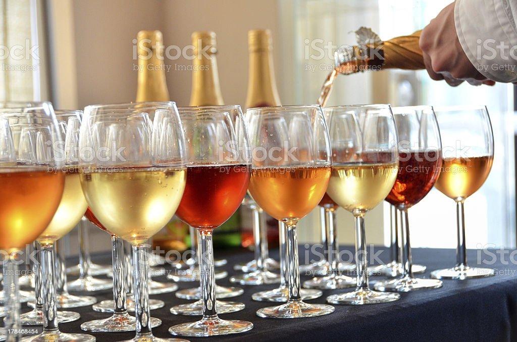 Filling Wine Glasses stock photo