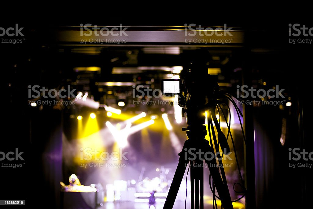 Film camera capturing stage event royalty-free stock photo