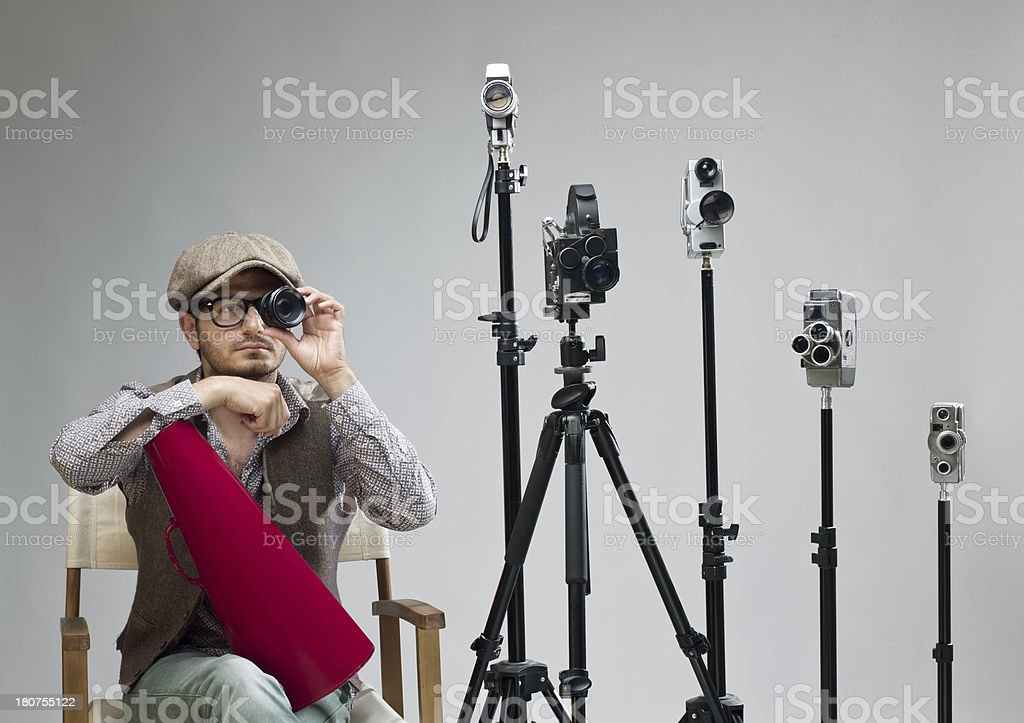 Film director behind camera holding lens for testing stock photo